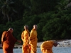 Buddhist monks on Mae Haad Beach